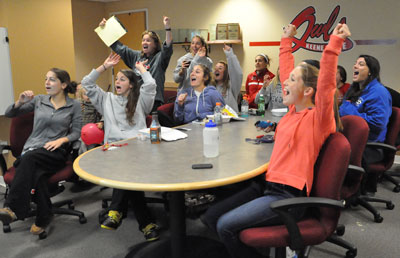 Women's Soccer Players and Coach Lyons react while watching NCAA Tournament selection show