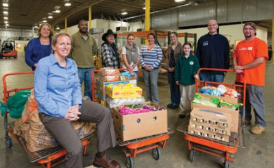 Mel Gosselin '90 with some of her staff at the New Hampshire Food Bank. Photo by John W. Hession.