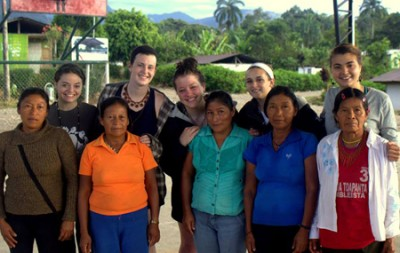 A few of the KSC students (in the back row: l–r, Jane Plummer, Katy McLaughlin, Mackenzie Prasch, Julia Forgione, and Molly Wolber) and their host moms from the Ecuadoran community of San Pedro.