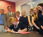 Governor Hassan signing HB 1444 into law