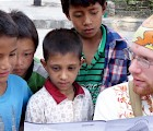 Keene State student Matt McDougal '15 talks with local children during a Morris-August Honors Program trip to Nepal. Courtesy photo