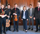 (L–R): Jonathan Way, Jordan Chase, Dan Ciccorello (with instruments), Maggie Hassan (center), José Lezcano (far right)