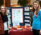 KSC Dietetic Interns Julia Whelan (at left) and Cassandra Reynolds with the Turn a New Leaf display at  Food Day 2014.