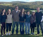 The research team on a downtime visit to Allyson's Orchards in Walpole, NH: (L–R) Aimee Joyce '13 (lab alum), Emma Speaks (volunteer from Monadnock Regional High School), Brad Stubenhaus '14 (research associate), Megan Beaudry (junior), Emily Neverett (senior), Alex Abbate (junior), Dr. Pellettieri. Not pictured: J.P. Dustin (senior), Maggie Kelly (senior), Caleb Larocca (junior), Derek Starkey (volunteer, UNH Class of 2013)