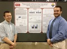Research Associate Nathan Martin (left) and chemistry and education double major Andrew Bosco presenting their poster at the ACS National Meeting