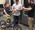 Nicholas Cusack gives his feedback on the final tweaks for his bike with SPDI designers Alex Delcore (middle) and Peter Solek.