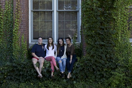Students sit in the ivy of a Parker Hall window. Photo by Will Wrobel.