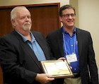 Gary Guzouskas (left) received the Richard Kay Memorial Award from William Van Tassel, Manager, Driver Training Programs, AAA National Office, in Portland, ME.