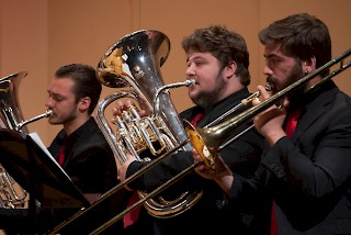 Students perform on brass instuments.