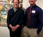 "Seth Kaiser (right) and Prof. Paul McMullan in front of ""Alchemy"" at Emerging Art 2013"