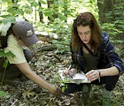 Environmental Studies senior Shauna Sousa (right) assists the Harris Center's Brett Thelen (left) with the organization's conservation efforts.