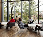 Students interact with each other in one of the new Living Learning Commons' open spaces.