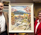 Jamie Trowbridge and Keene State President Anne Huot with BeaTrix Sagendorph's painting of Mt. Monadnock and Dublin Lake