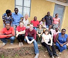 Architecture majors Rachel Lamica and Connor Bell with professors Donna Paley and Peter Temple at Father Roberts' home in Bucundura, Uganda. The woman in the white shirt and dark pants in the front row is a member of Father Roberts congregation at St. Bernard's Church, Ann Ball.