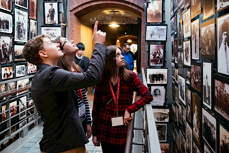 Seniors Galen Gammino and Madison Strausser get a history lesson from Emily Robinson '16 at the United States Holocaust Memorial Museum in Washington, DC. Photo by Will Wrobel