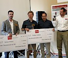 (Left to right) Samuel Wilson and William Hadden receive big scholarship checks from Fenton representatives Bob Swartz and George Thompson.