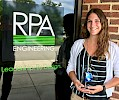 Taylor Warriner '15 with her Innovation Award from RPA Engineering