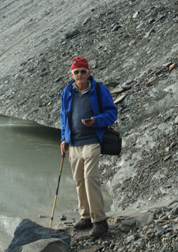Dr. Bayr, with GPS in hand, on the Pasterze Glacier till.