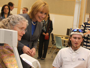 Assistant Professor Lisa Hix (left) and SPDI major Nick Bailey (right) show Governor-Elect Maggie Hassan some of the cutting-edge technology available in the TDS Center.
