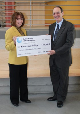 Bonnie Kurylo, PSNH Western/Central Division Manager, presents a rebate check to Interim President Jay Kahn