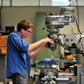 A student at work in the newly constructed TDS Center, where manufacturing classes take place.
