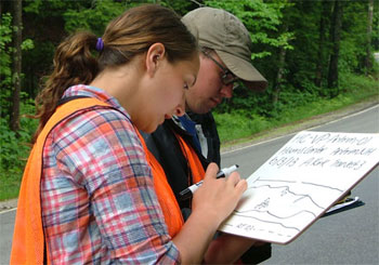 Alexandra Kirk and Stephen Day creating a detailed field sketch of a roadside vernal pool as part of the vernal-pool documentation process.