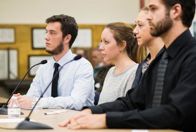 Dr. Marjorie Droppa's students provide recommendations to the Keene Board of Education on how to reduce substance abuse. (l–r: Zachary Bischoff, Amanda Hall, Emily Thomas, Anthony Quintiliani) Will Wrobel photo.