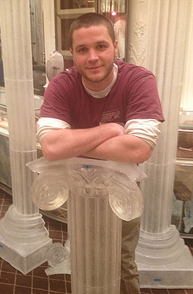 Chris Bell '11 with the resin-cast columns he made for the Bergdorf Goodman holiday display. The columns were made to look like they're carved from ice.