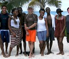 Scott Strong (center, in orange shorts) and Karen Cangialosi (far right) with local students on Providenciales