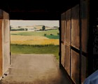 Peter Roos in a self portrait he painted (a diptych), using a scene from his late cousin's Danish farm house.