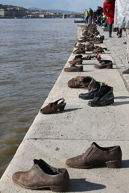 Budapest Shoes (Hungary) - During WWII, Jews were told to stand on the edge of the Danube River, step out of their shoes, and were shot in the water. This is a memorial in Budapest in honor of those who died this way. (Kayla Magan, Jagiellonian University - Krakow, Poland)