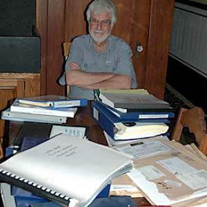 Dr. Larry Benaquist with just some of the records...