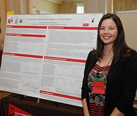 Emily Wollert giving a poster presentation