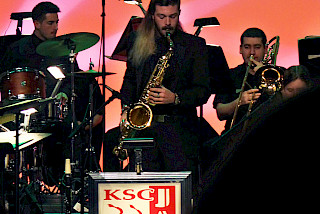 Saxophone player solos at Jazz concert.