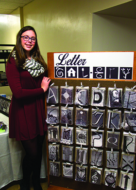 Mackenzie McGreer sells her wares at a PTA holiday craft fair at the Wheelock...