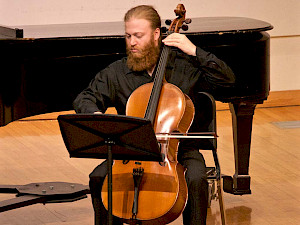 A cellist performs with the String Ensembles.