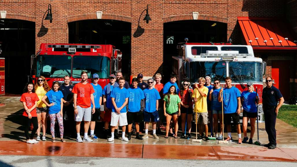 Group photo in front of the fire station