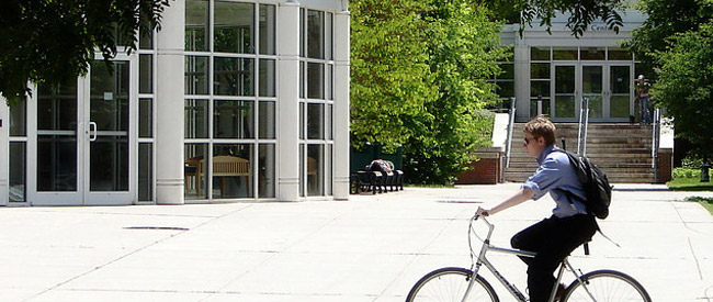 Cyclist in front of Rhodes Hall