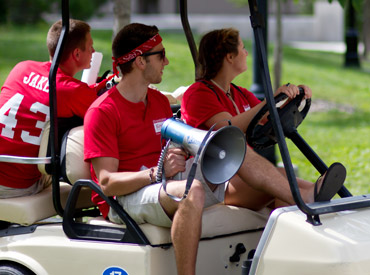 Students in a golf cart during Orientation