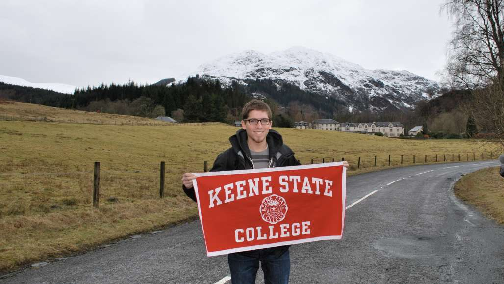 Student with KSC banner