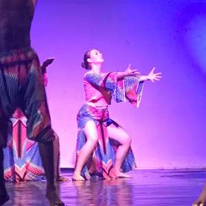 Olivia Miller performing with Ghanaian dancers