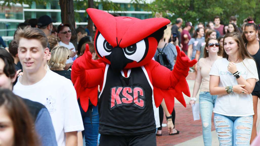 Hootie leads first-year students down Appian Way during Clap-In in August