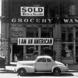 "Following evacuation orders, this store was closed.   The owner, a University of California graduate of Japanese descent, placed the ""I AM AN AMERICAN"" sign on the store front the day after Pearl Harbor.  Oakland, CA, April 1942.  Dorothea Lange. (WRA)Exact Date Shot unknownNARA FILE #:  210-G-2A-35WAR & CONFLICT #:  772"