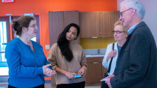 Professor Duggan, left, talks with student Puja Thapa and Mary and Bob Rooney. Puja interviewed Bob Rooney for her course blog.