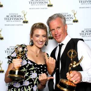 Tom Cole, pictured right, with Katie Eastman after winning a 2019 Regional Emmy Award for his work on Race Across America. Photo courtesy of Tom Cole.