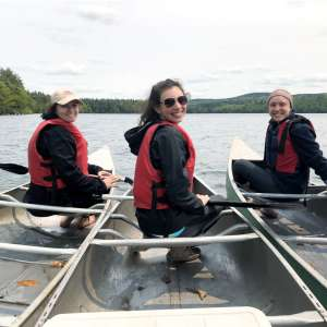 From left, Katelyn Fournier, Kristina Tufo, and Julia Yates doing conservation easement monitoring on Spoonwood Pond.