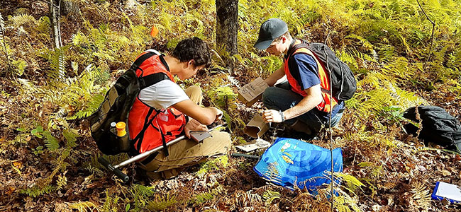 Ezra Richardson and Garrett Hopkins studied post-wildfire soil conditions. (photo: Courtney Dillon)